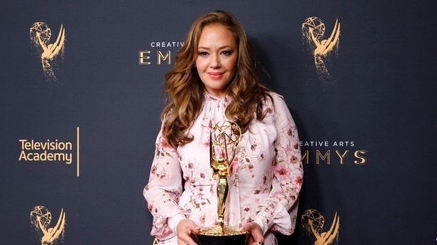 "Leah Remini holds her Emmy Award for Outstanding Informational Series Or Special for ""Leah Remini: Scientology And The Aftermath"" backstage at the 2017 Creative Arts Emmy Awards in Los Angeles, California, U.S. September 9, 2017. REUTERS/Danny Moloshok - RC1FC544E880"