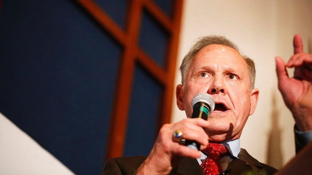 Former Alabama Chief Justice and U.S. Senate candidate Roy Moore speaks to supporters, Tuesday, Aug. 15, 2017, in Montgomery, Ala. Moore, who took losing stands for the public display of the Ten Commandments and against gay marriage, forced a Senate primary runoff with Sen. Luther Strange, an appointed incumbent backed by both President Donald Trump and heavy investment from establishment Republican forces. (AP Photo/Brynn Anderson)