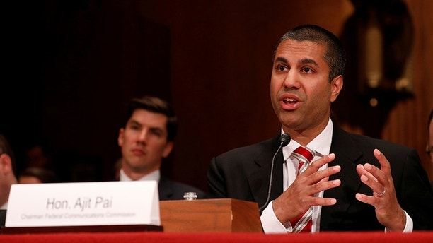Ajit Pai, Chairman of the Federal Communications Commission, testifies before a Senate Appropriations Financial Services and General Government Subcommittee on Capitol Hill in Washington, U.S., June 20, 2017. REUTERS/Aaron P. Bernstein - RC1E2880C590
