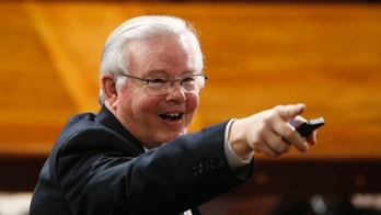 U.S. Rep Joe Barton (R-TX) points to another attendee in the House chamber prior to Israeli Prime Minister Benjamin Netanyahu's address to a joint meeting of Congress on Capitol Hill in Washington, March 3, 2015. REUTERS/Jonathan Ernst (UNITED STATES  - Tags: POLITICS)   - TB3EB331FT5D3