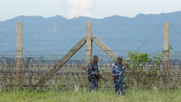 Myanmar border guard police force patrol near the Myanmar-Bangladeshi border outside Maungdaw, northern Rakhine state, Myanmar, November 12, 2017. Picture taken on November 12, 2017. REUTERS/Wa Lone - RC16C7540B10