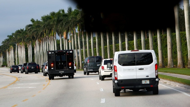 The motorcade of U.S. President Donald Trump arrives at Trump International Golf Club in West Palm Beach, Florida, U.S., November 25, 2017. REUTERS/Eric Thayer - RC1555D514C0