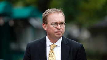 FILE - In this Sept. 13, 2017 file photo, Director of the Office of Management and Budget Mick Mulvaney departs after a television interview at the White House in Washington. (AP Photo/Alex Brandon, File)
