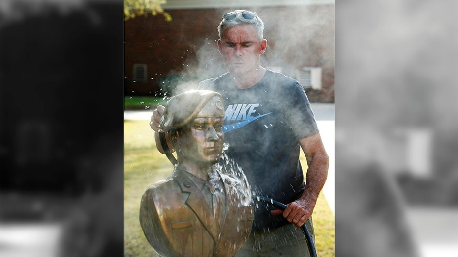Retired Col. Lee Busby is entering the Alabama Senate race with a long-shot bid against embattled Republican Roy Moore. He is also an artist who sculpts Alabamian troops who have been killed in Iraq or Afghanistan. (Gary Cosby Jr./The Tuscaloosa News via AP)