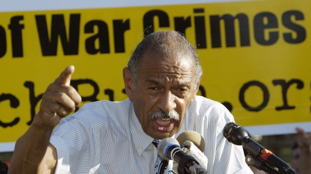 """U.S. Representative John Conyers (D-MI) speaks at an anti-war rally near the White House in Washington, DC June 16, 2005, after delivering a petition to The White House signed by over 500,000 Americans and 94 members of U.S. Congress asking U.S. President George W. Bush to respond to questions raised by the """"Downing Street Minutes"""". The Downing Street memo produced for British Prime Minister Tony Blair in July 2002 portrayed Bush as inevitably invading Iraq and said """"intelligence and facts"""" were being fixed eight months before the March 2003 invasion. Bush and Blair dismissed this. REUTERS/Chris Kleponis CK/TC - RP6DRNASDTAD"""