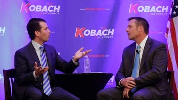 Donald Trump Jr., left, and Kansas Secretary of State Kris Kobach talk during a fundraiser for Kobach's campaign for governor Tuesday, Nov. 28, 2017, in Overland Park, Kan. (AP Photo/Charlie Riedel)