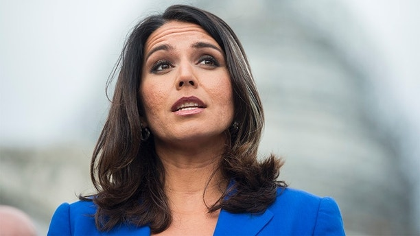 UNITED STATES - NOVEMBER 18: Rep. Tulsi Gabbard, D-Hawaii, speaks during a news conference on the Trans-Pacific Partnership outside of the U.S. Capitol on Wednesday, Nov. 18, 2015. (Photo By Bill Clark/CQ Roll Call)