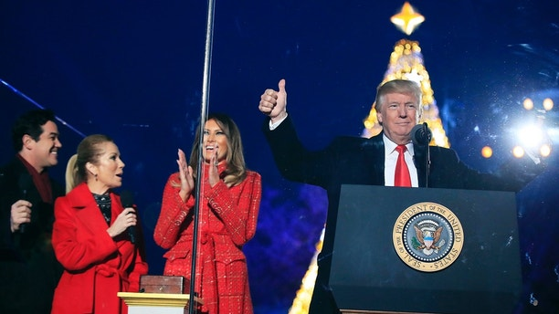 President Donald Trump and first lady Melania Trump, cheer after lighting the 2017 National Christmas Tree during the National Christmas Tree lighting ceremony at the Ellipse near the White House in Washington, Thursday, Nov. 30, 2017. With the president and the first lady are hosts for the event, Kathie Lee Gifford and actor Dean Cain. (AP Photo/Manuel Balce Ceneta)