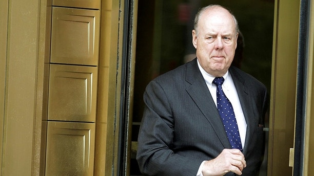 FILE PHOTO:  Lawyer John Dowd exits Manhattan Federal Court in New York, U.S. on May 11, 2011. REUTERS/Brendan McDermid/File Photo - RC1B8251FB10