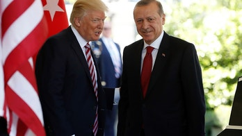 In this May 16, 2017, photo, President Donald Trump welcomes Turkish President Recep Tayyip Erdogan to the White House in Washington. The Trump administration faced growing calls Thursday for a forceful response to violence by Turkish presidential guards on American soil, who were briefly detained this week but then set free. The unseemly incident added to U.S.-Turkish tensions that are being compounded by a growing spat over U.S. war strategy against the Islamic State group in Syria. (AP Photo/Pablo Martinez Monsivais, File)