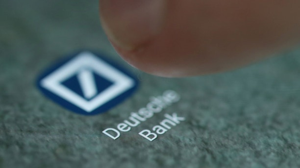 The Deutsche Bank app logo is seen on a smartphone in this picture illustration taken September 15, 2017. REUTERS/Dado Ruvic/Illustration - RC1D3062E430