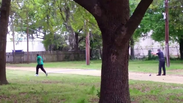 North Charleston police officer Michael Slager (R) is seen allegedly shooting 50-year-old Walter Scott in the back as he runs away, in this still image from video in North Charleston, South Carolina taken April 4, 2015. Slager was charged with murder on April 7 after a video showed him shooting eight times at the back of Scott who was running away. North Charleston Mayor Keith Summey said state investigators decided to charge officer Slager, 33, with the murder of Scott after they viewed the video of the incident, which followed a traffic stop on Saturday morning. The FBI and U.S. Justice Department have begun a separate investigation. REUTERS/Feidin Santana/handout via Reuters  EDITORIAL USE ONLY. MANDATORY CREDIT. - GF10000052082