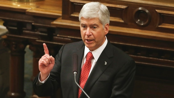 FILE-- In this Jan. 16, 2013 file photo, Michigan Gov. Rick Snyder delivers his third annual State of the State address to a joint session of the state Legislature in the Capitol in Lansing, Mich. Snyder typically isn't bashful about unveiling major initiatives at his annual State of the State speech. This election year, though, could be more of a pep talk and run-down of his accomplishments.  (AP Photo/Carlos Osorio)