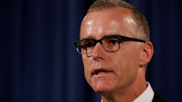 Acting FBI Director Andrew McCabe announces the results of the national health care fraud takedown during a news conference at the Justice Department in Washington, U.S., July 13, 2017. REUTERS/Aaron P. Bernstein - RC187D475C60