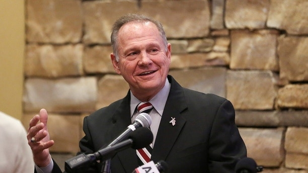 Judge Roy Moore speaks as he participates in the Mid-Alabama Republican Club's Veterans Day Program in Vestavia Hills, Alabama, U.S. November 11, 2017. REUTERS/Marvin Gentry - RC12B2D023E0