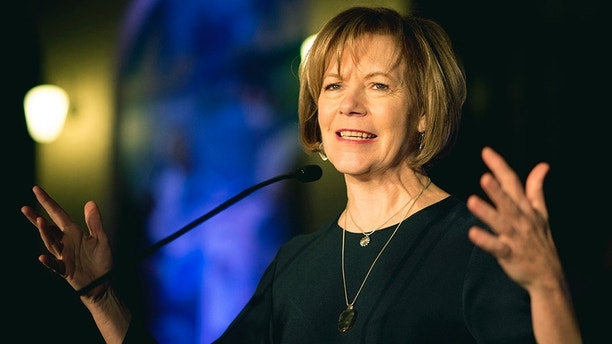FILE - In this Jan. 10, 2015, file photo, Minnesota Lt. Gov. Tina Smith speaks in St. Paul, Minn. Smith is a possible replacement to fill U.S. Sen. Al Franken's seat after he announced his resignation amid multiple sexual misconduct allegations Thursday, Dec. 7, 2017, on the Senate floor in Washington. His resignation means Minnesota Gov. Mark Dayton, a fellow Democrat, will name a temporary replacement. The winner of a special election in November would serve through the end of Franken's term in January of 2021. (Aaron Lavinsky /Star Tribune via AP, File)