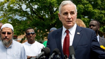 Minnesota Gov. Mark Dayton speaks at a news conference at the Dar Al Farooq Islamic Center in Bloomington, Minn., on Sunday, Aug. 6, 2017, where an explosion damaged a room and shattered windows as worshippers prepared for morning prayers early Saturday. (Courtney Pedroza/Star Tribune via AP)