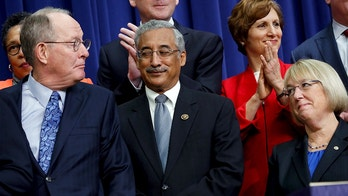 (L-R) U.S. Senator Lamar Alexander (R-TN), Representative Bobby Scott (D-VA) and Senator Patty Murray (D-WA) share a look as U.S. President Barack Obama (not pictured) mentions their bipartisan effort on the Every Student Succeeds Act before signing it into law in the Eisenhower Executive Office Building at the White House in Washington, December 10, 2015. REUTERS/Jonathan Ernst - GF10000261348