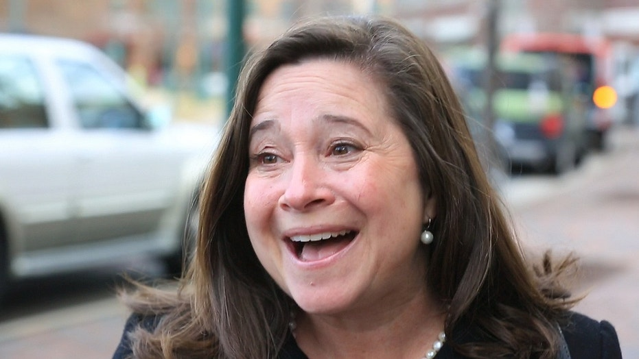 Democrat Shelly Simonds reacts to the news that she won the 94th District precincts by one vote after previously trailing incumbent David Yancey by ten votes post-election, following a recount Tuesday, Dec. 19, 2017, in Hampton, Va. (Joe Fudge/The Daily Press via AP)
