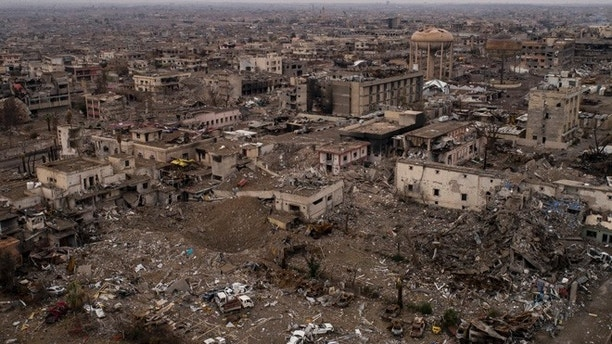 In this Nov. 9, 2017 photo, aerial view of the damaged hospital complex and surrounding areas in Mosul, Iraq. The complex, located in Mosul's al-Shifaa neighborhood, was the main medical center for the Islamic State group during its rule and was heavily damaged during fighting when Iraqi forces wrested Mosul back from the militants. (AP Photo/Felipe Dana)