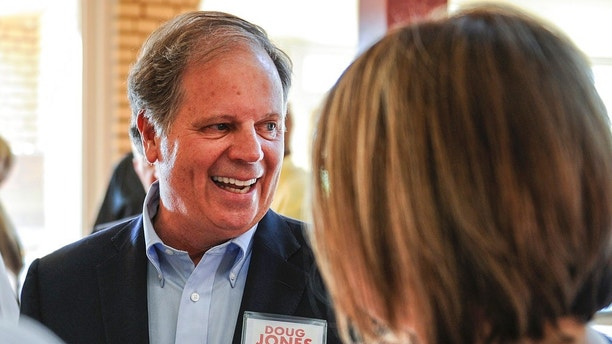 FILE - In this Aug. 3, 2017, file photo, candidate Doug Jones chats with constituents before a Democratic Senate candidate forum at the Princess Theatre in Decatur, Ala.   Jones is facing Michael Hansen , who leads an environmental group, in the Democrat primary on Tuesday, Aug. 15.  .  (Jeronimo Nisa /The Decatur Daily via AP, File)