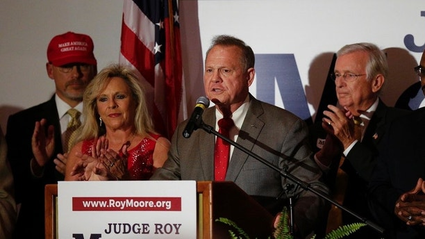 Former Alabama Chief Justice and U.S. Senate candidate Roy Moore during his election party, Tuesday, Sept. 26, 2017, in Montgomery, Ala. Moore won the Alabama Republican primary runoff for U.S. Senate on Tuesday, defeating an appointed incumbent backed by President Donald Trump and allies of Sen. Mitch McConnell. (AP Photo/Brynn Anderson)