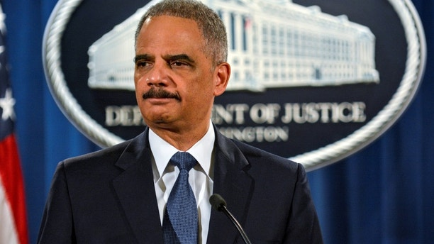 FILE PHOTO: Then U.S. Attorney General Eric Holder addresses a Justice Department news conference in Washington, U.S., March 4, 2015. To match OBAMA-LAWYERS/ REUTERS/James Lawler Duggan/Files - RC14EC17B080
