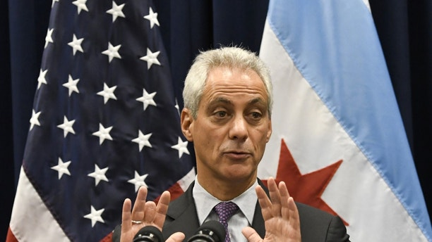 FILE - In this Jan. 25, 2017 photo, Chicago Mayor Rahm Emanuel speaks during a press conference where sanctuary cities, which don't arrest or detain immigrants living in the U.S. illegally, and Chicago violence, two issues raised by President Donald Trump, were discussed in Chicago. (AP Photo/Matt Marton, File)