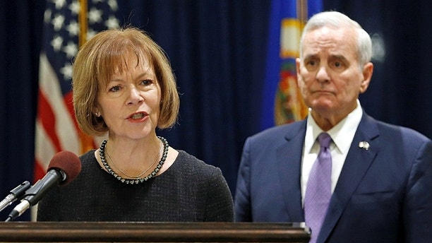 Minnesota Lieutenant Governor Tina Smith answers a question after Minnesota Governor Mark Dayton (R) announced Smith to replace U.S. Senator Al Franken at the State Capitol in St. Paul, Minnesota, U.S. December 13, 2017. REUTERS/Eric Miller - RC1EFE91F190