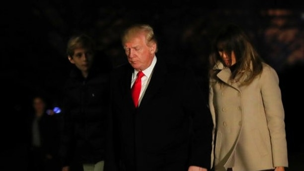 President Donald Trump together with first lady Melania Trump and their son Barron Trump returns to the White House in Washington, Monday, Jan. 1, 2018, from a holiday break at his Mar-a-Lago estate in Palm Beach, Fla. (AP Photo/Manuel Balce Ceneta)