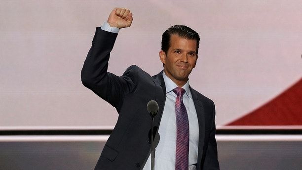 Donald Trump Jr. thrusts his fist after speaking at the 2016 Republican National Convention in Cleveland, Ohio U.S. July 19, 2016.  REUTERS/Mike Segar - RC14B39AFF00