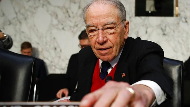 "Senate Judiciary Committee Chairman Chuck Grassley, R-Iowa, arrives for a Senate Judiciary Committee hearing on Capitol Hill in Washington, Wednesday, Dec. 6, 2017, entitled: ""Firearm Accessory Regulation and Enforcing Federal and State Reporting to the National Instant Criminal Background Check System (NICS)."" (AP Photo/Carolyn Kaster)"