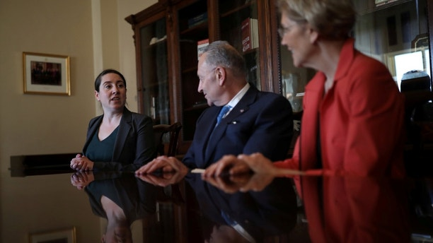 Leandra English (L), current acting director of the Consumer Financial Protection Bureau (CFPB) meets with Senate Democratic Leader Chuck Schumer (D-NY) and Senator Elizabeth Warren (D-MA) in Capitol Hill, Washington, D.C.,  November 27, 2017. REUTERS/Carlos Barria