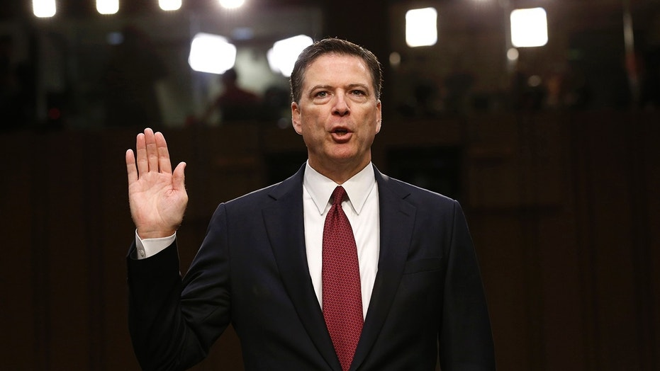 Former FBI Director James Comey is sworn in prior to testifying before a Senate Intelligence Committee hearing on Russia's alleged interference in the 2016 U.S. presidential election on Capitol Hill in Washington, U.S., June 8, 2017.