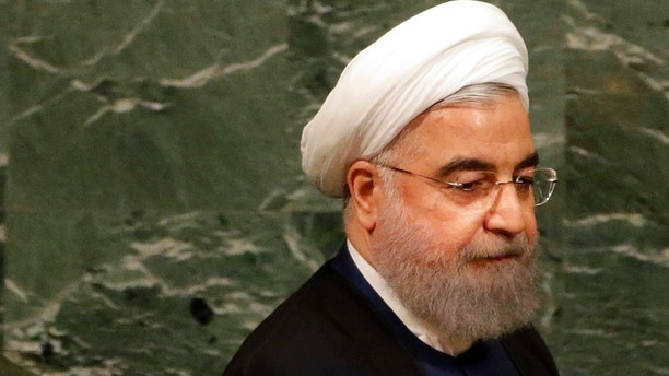 Iranian President Hassan Rouhani prepares to speak during the United Nations General Assembly at U.N. headquarters, Wednesday, Sept. 20, 2017. (AP Photo/Seth Wenig)