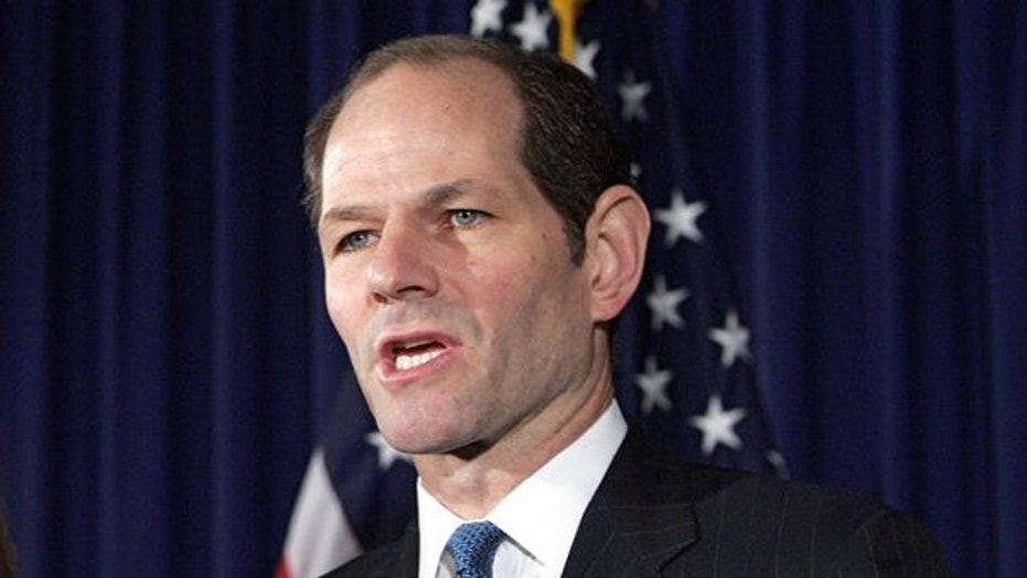 March 12, 2008: former New York Gov. Eliot Spitzer is seen announcing his resignation.