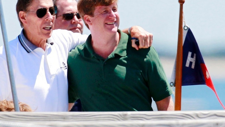 Former U.S. Sen. John Tunney, left, accompanies Patrick Kennedy on a pier in Hyannis Port, Mass., in July 2011. Tunney died at age 83 on Jan. 12, 2018.