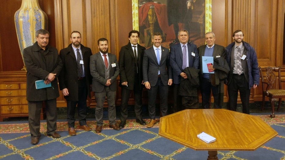 Members of the delegation of the Free Syrian Army pose with Representative Adam Kinzinger, R-Ill. (fourth from the right)