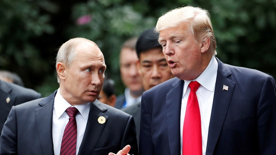 November 11, 2017: U.S. President Donald Trump and Russia's President Vladimir Putin talk during the family photo session at the APEC Summit in Danang, Vietnam.