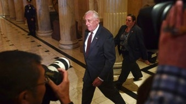House Minority Whip Steny Hoyer, D-Md., walks past reporters on Capitol Hill in Washington, Thursday, Nov. 16, 2017. (AP Photo/Susan Walsh)