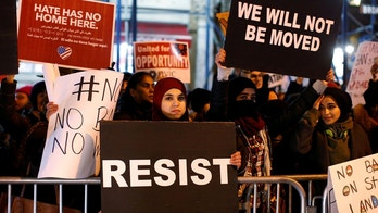 People protest against President Donald Trump's travel ban in New York City, U.S., February 1, 2017.  REUTERS/Brendan McDermid - RC120820CA50