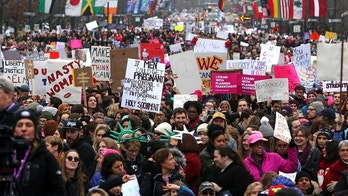 "FILE - In this Jan. 21, 2017, file photo, thousands of protesters, on the day after Republican President Donald Trump's inauguration, participate in a women's march on the Benjamin Franklin Parkway in Philadelphia. Police in Philadelphia say reports that officers will be randomly searching attendees at a women's march on Saturday, Jan. 20, 2018, are inaccurate.  Deputy Commissioner Dennis Wilson says police ""are not frisking people"" and ""are not infringing on anyone's First Amendment rights in any way."" (AP Photo/Jacqueline Larma, File)"