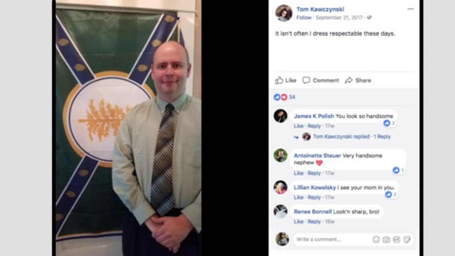 Jackman Town Manager Tom Kawczynski poses in front of his flag for his New Albion racial segregationist group on his Facebook page.