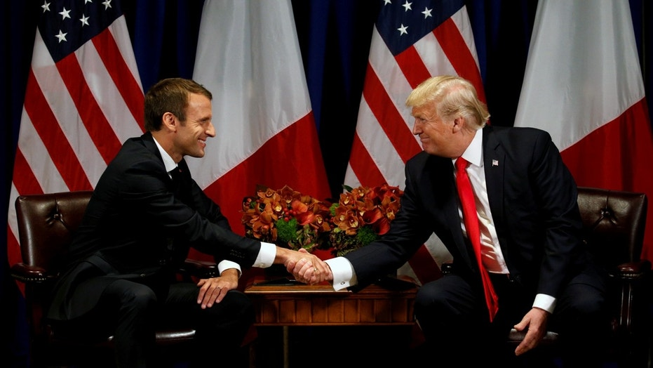 \Trump and French President Emmanuel Macron shake hands during a meeting on the sidelines of the United Nations General Assembly in New York this past September.\