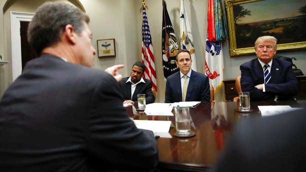 From left, Kansas Gov. Sam Brownback gestures as he speaks as Darrell Scott Senior Pastor of the New Spirit Revival Center, Kentucky Gov. Matt Bevin, and President Donald Trump participate in a prison reform roundtable in the Roosevelt Room of the Washington, Thursday, Jan. 11, 2018. (AP Photo/Carolyn Kaster)