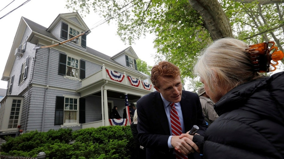 U.S. Rep. Joe Kennedy III greets a well-wisher during ceremonies on the 100th anniversary of the birth of his great-uncle President John F. Kennedy outside the home where JFK was born in Brookline Mass