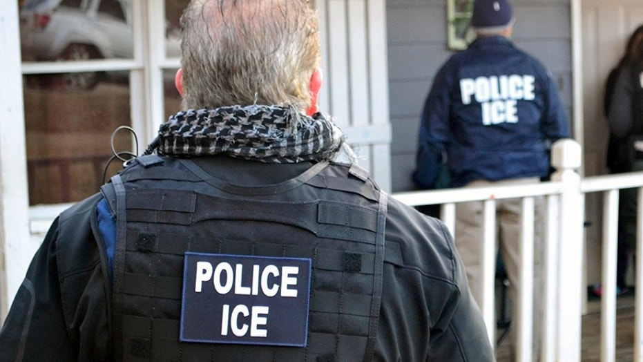 Agents from U.S. Immigration and Customs Enforcement (ICE) conduct a raid in Atlanta, Feb. 9, 2017.