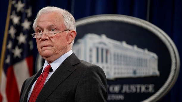 "U.S. Attorney General Jeff Sessions stands during a news conference to discuss ""efforts to reduce violent crime"" at the Department of Justice in Washington, U.S., December 15, 2017.   REUTERS/Joshua Roberts - RC11447E3F70"