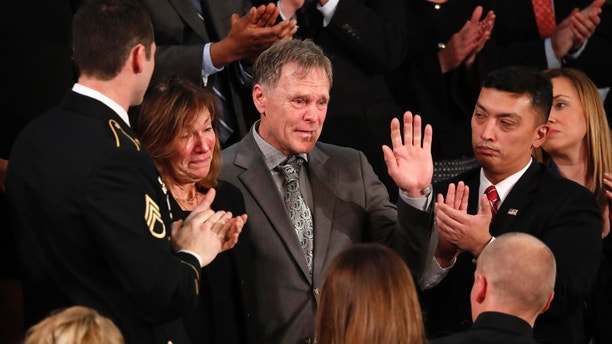 American student Otto Warmbier's parents Fred and Cindy Warmbier cry as U.S. President Donald Trump talks about the death of their son Otto after his arrest in North Korea during the State of the Union address to a joint session of the U.S. Congress on Capitol Hill in Washington, U.S. January 30, 2018. REUTERS/Jonathan Ernst - HP1EE1V09VLZL