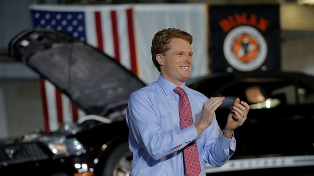 U.S. Rep. Joe Kennedy III (D-MA) takes the stage to deliver the Democratic rebuttal to U.S. President Donald Trump's State of the Union address in Fall River, Massachusetts, U.S., January 30, 2018.   REUTERS/Brian Snyder - RC1895B22080